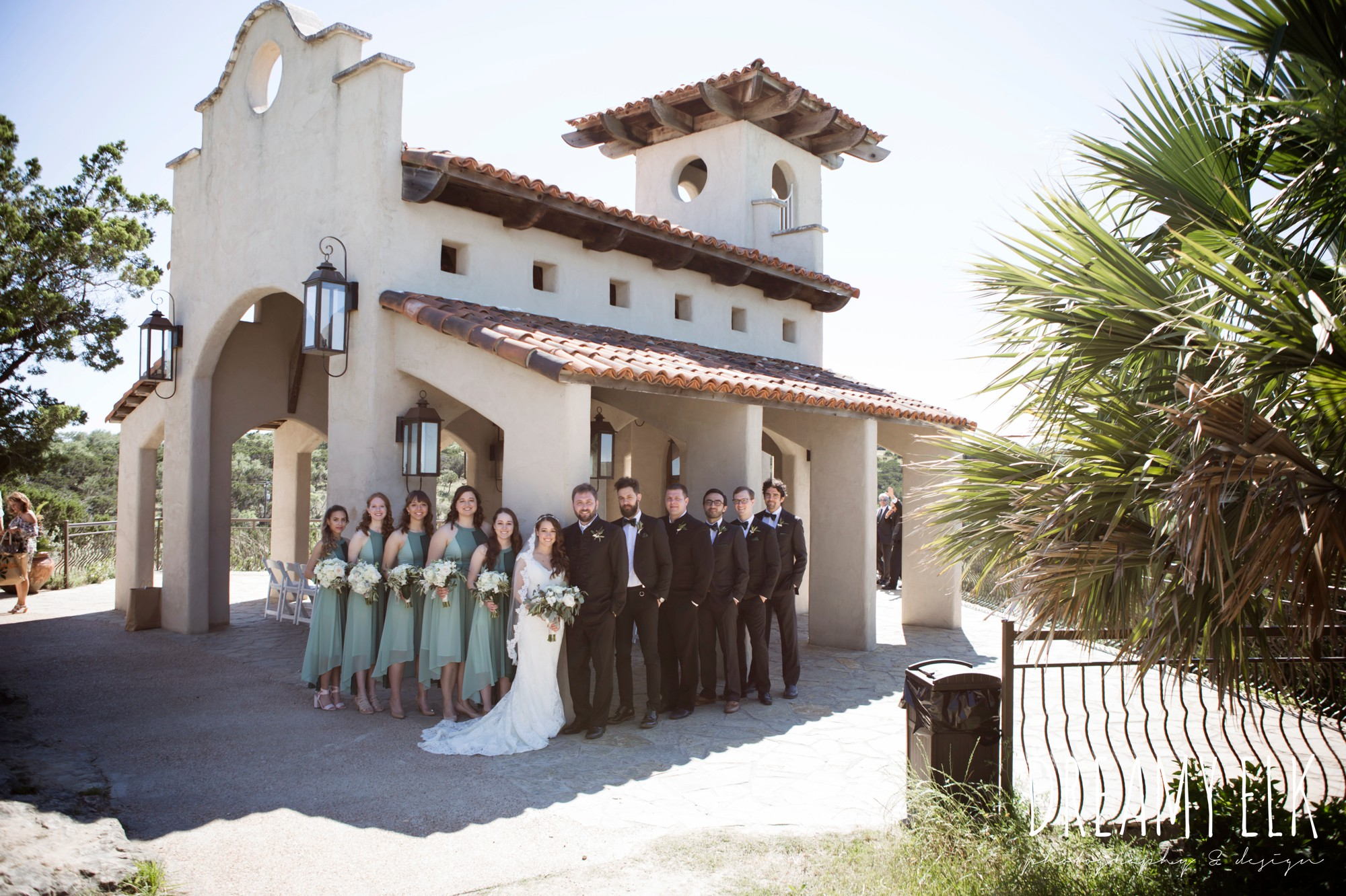 bride, bridesmaids, green bridesmaids dresses, mod cloth, groom, traditional hungarian tux, groomsmen, outdoor spring april wedding photo, chapel dulcinea ceremony, thurman's mansion, dripping springs, texas {dreamy elk photography and design}