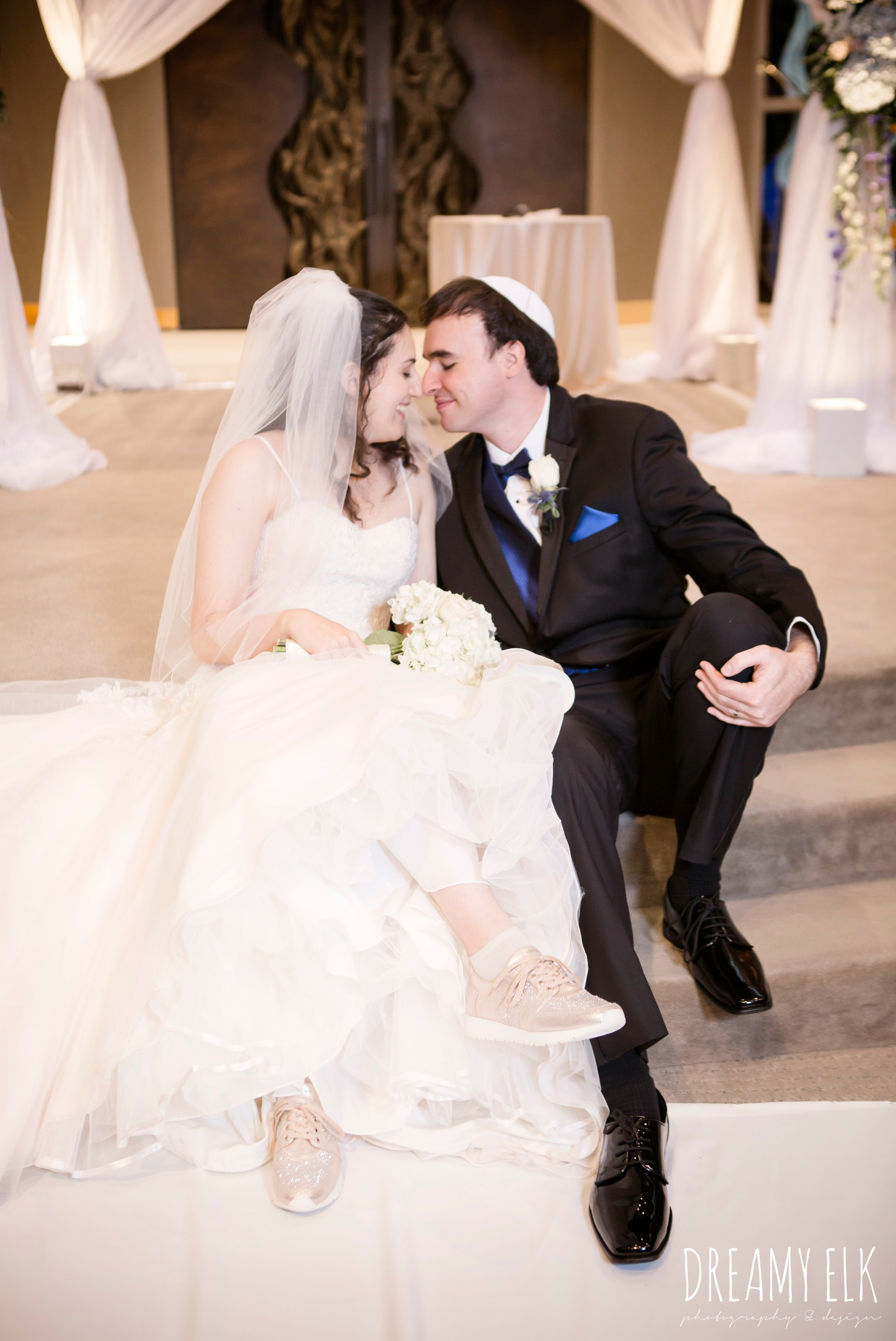 bride and groom in tennis shoes, summer june jewish wedding photo {dreamy elk photography and design}