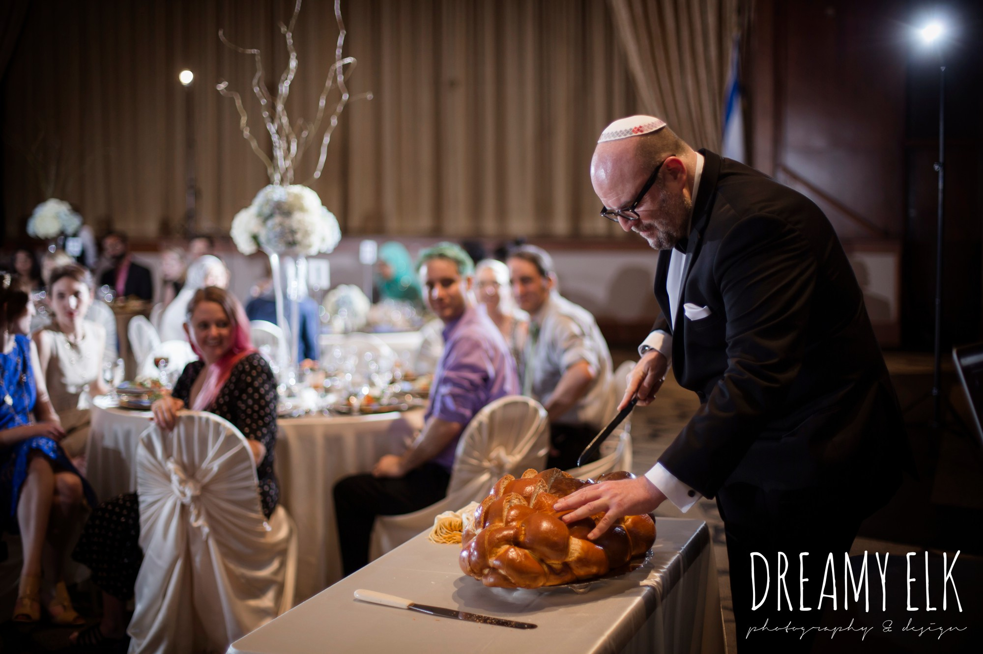 blessing and cutting challah bread, summer june jewish wedding photo {dreamy elk photography and design}