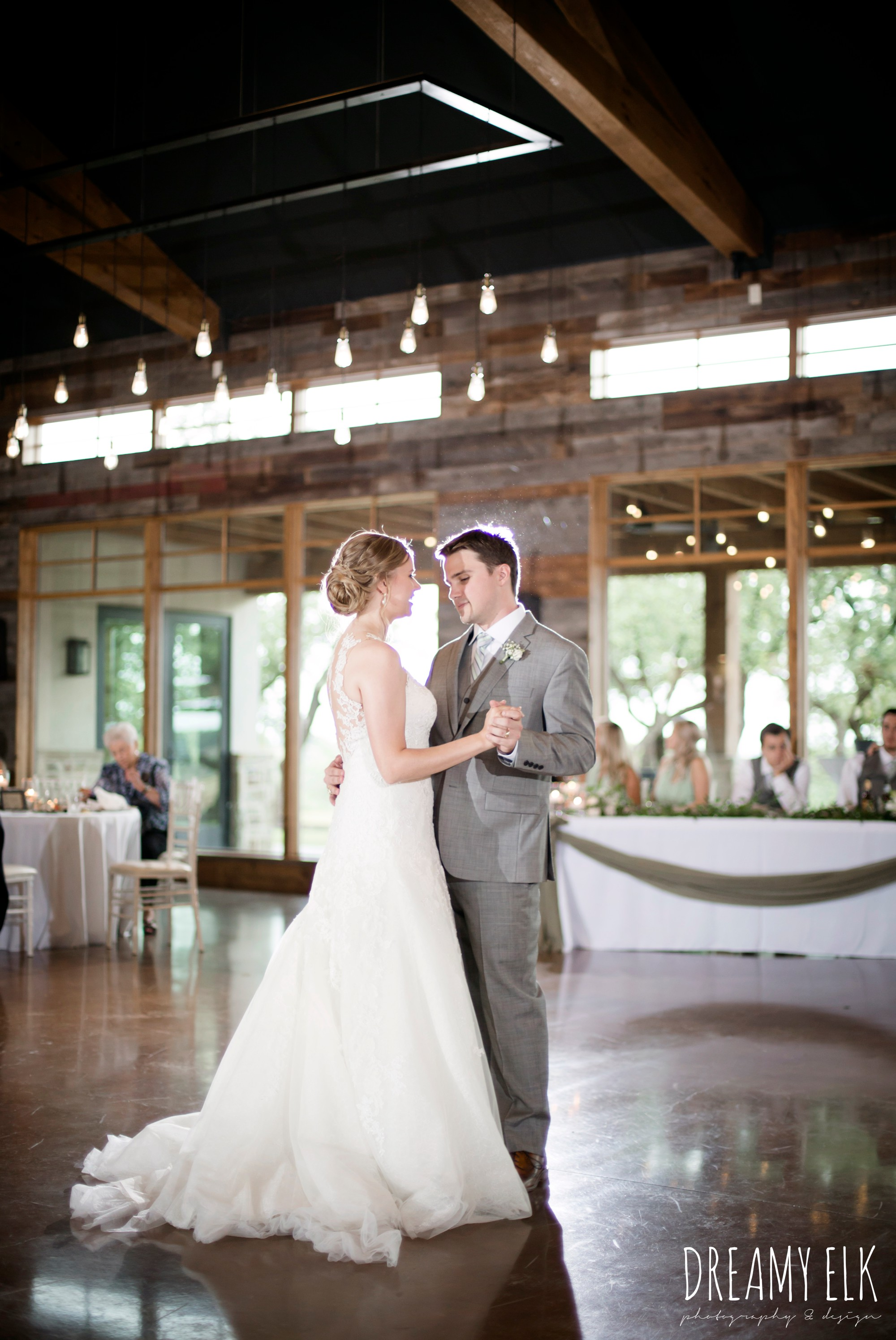 indoor wedding reception, bride and groom first dance, summer july wedding photo, canyonwood ridge, dripping springs, texas {dreamy elk photography and design}