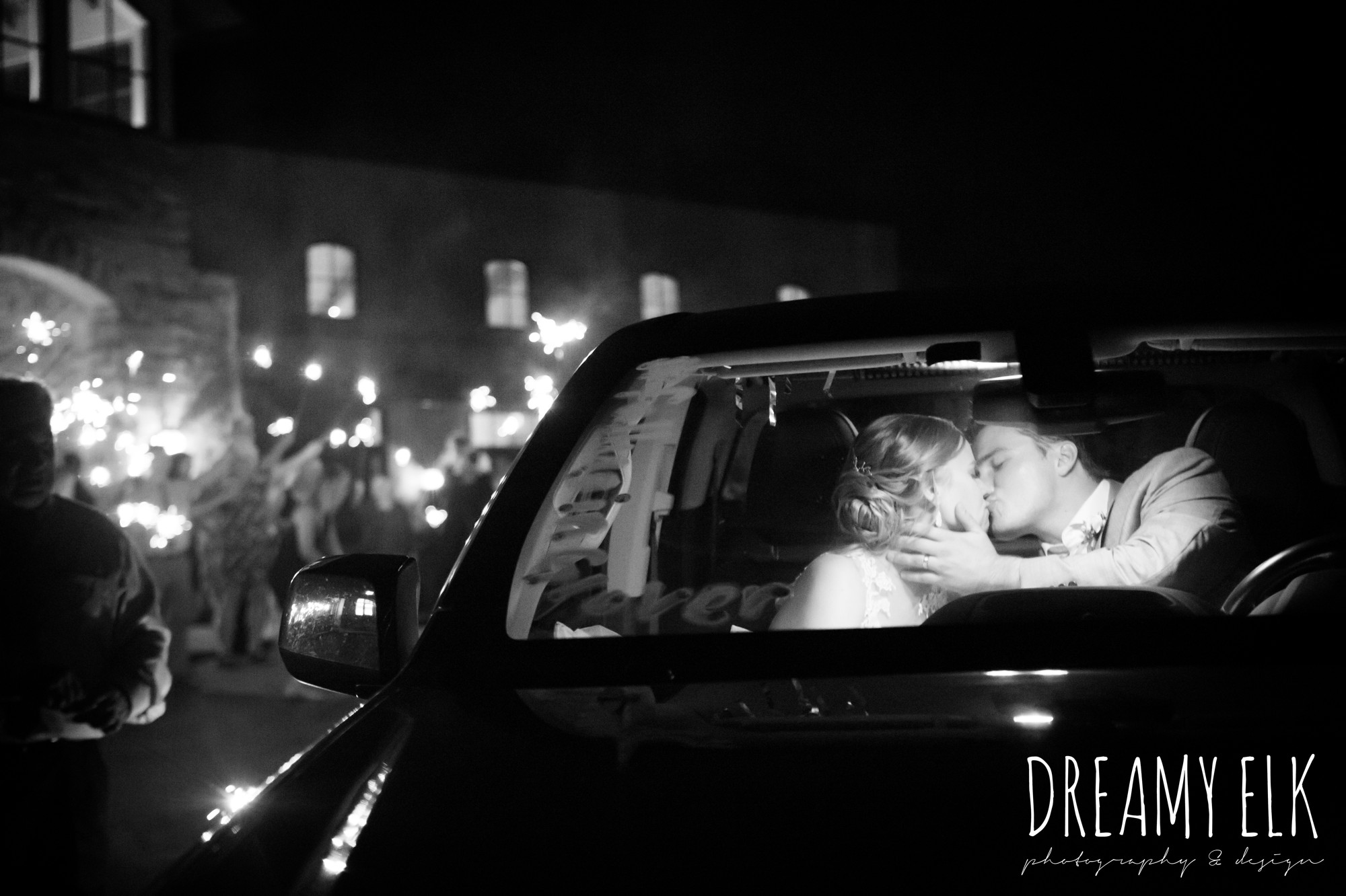 sparkler send off, bride and groom kissing in the car, summer july wedding photo, canyonwood ridge, dripping springs, texas {dreamy elk photography and design}