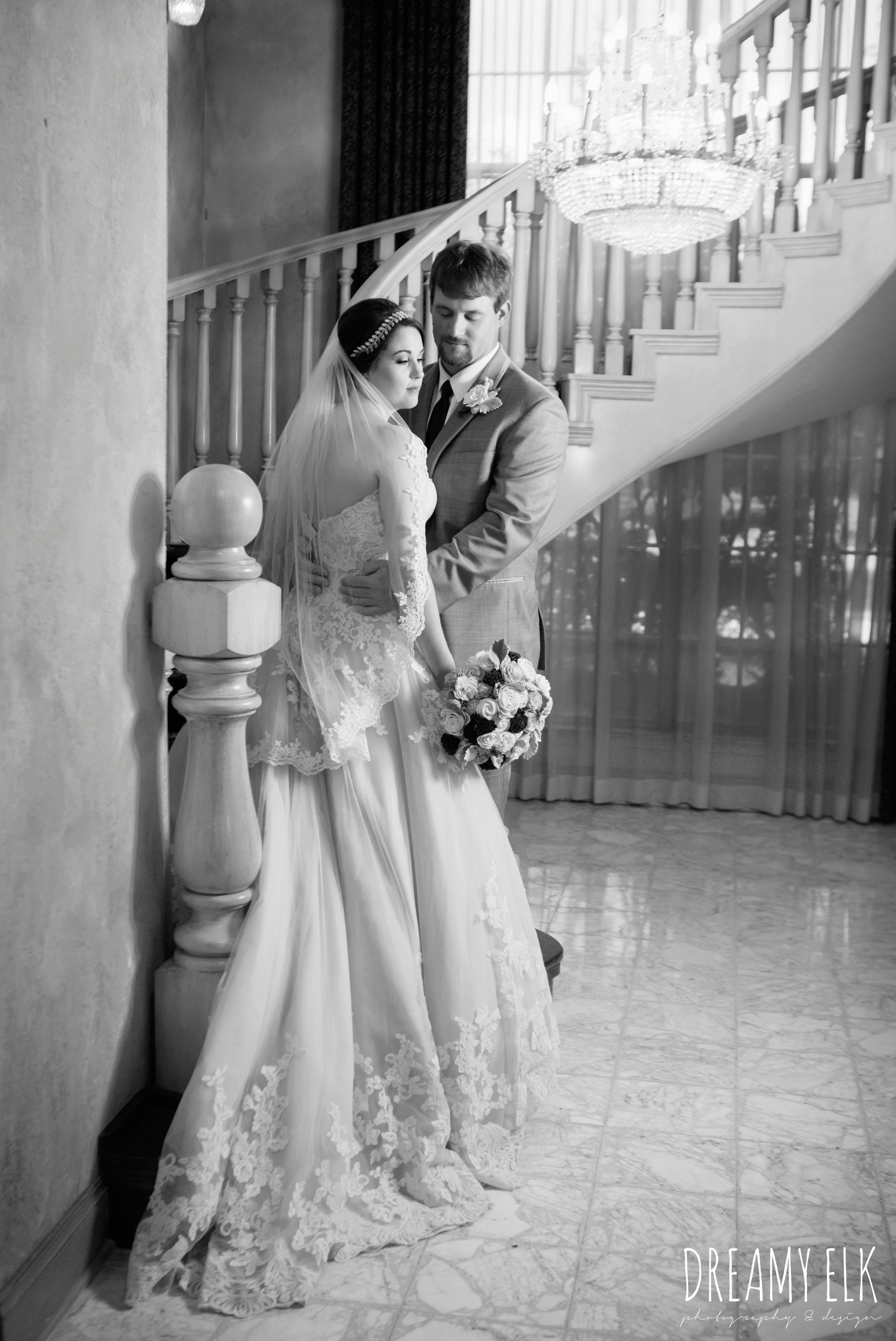 bride and groom on staircase, bride, sweetheart lace ballgown wedding dress, oyester underlay, lace trimmed veil, rhinestone headpiece, groom, men's wearhouse gray tux with maroon vest and tie, september wedding photo, ashelynn manor, magnolia, texas, austin texas wedding photographer {dreamy elk photography and design}