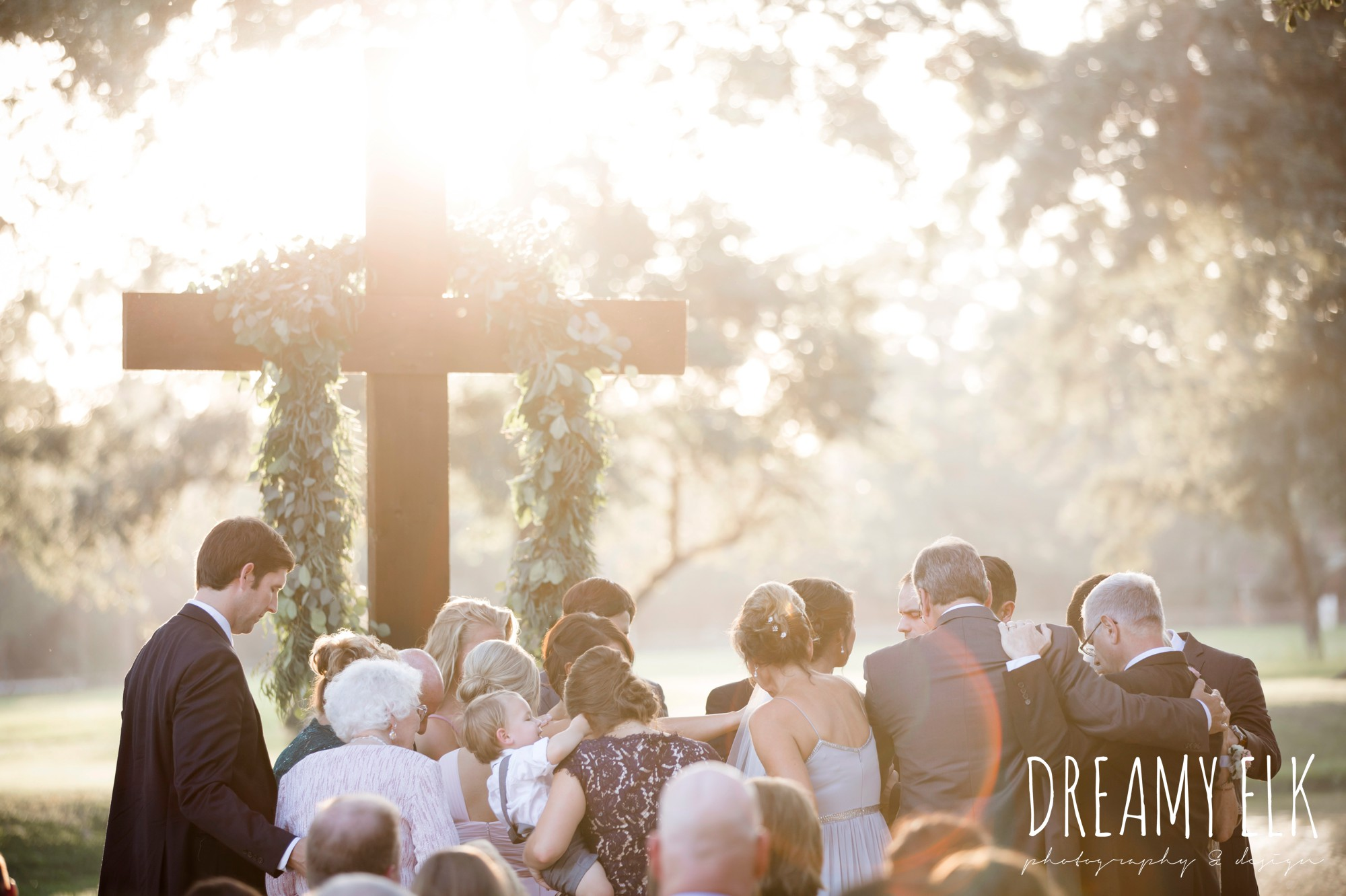 family prayer, sunset wedding ceremony, outdoor fall october wedding photo, blush and gray wedding, balmorhea weddings and events, dreamy elk photography and design, austin texas wedding photographer