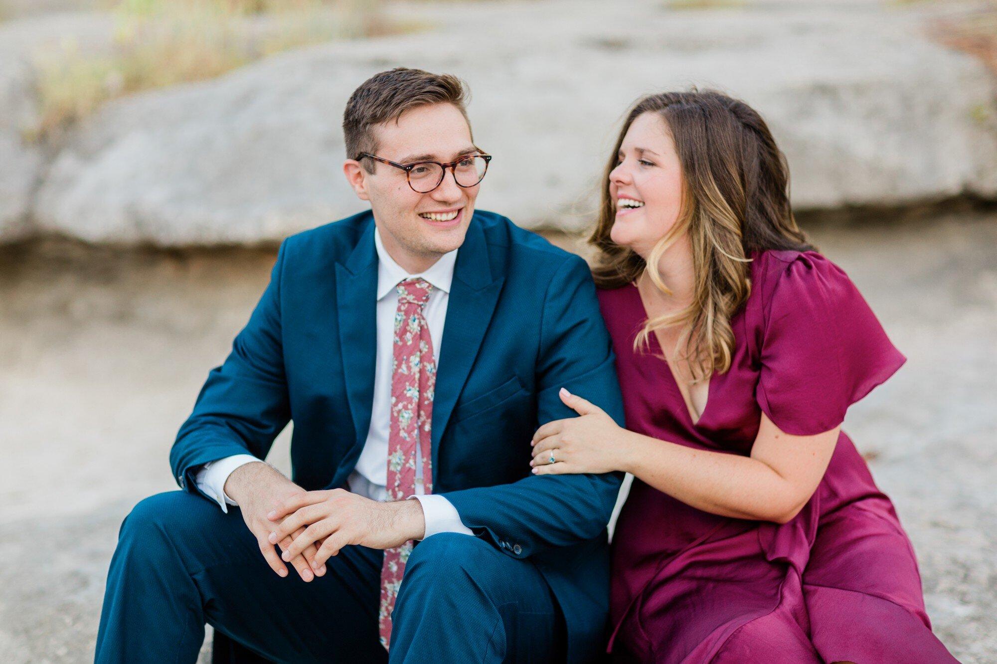 bull creek park austin texas engagement photo, burgundy dress and suit