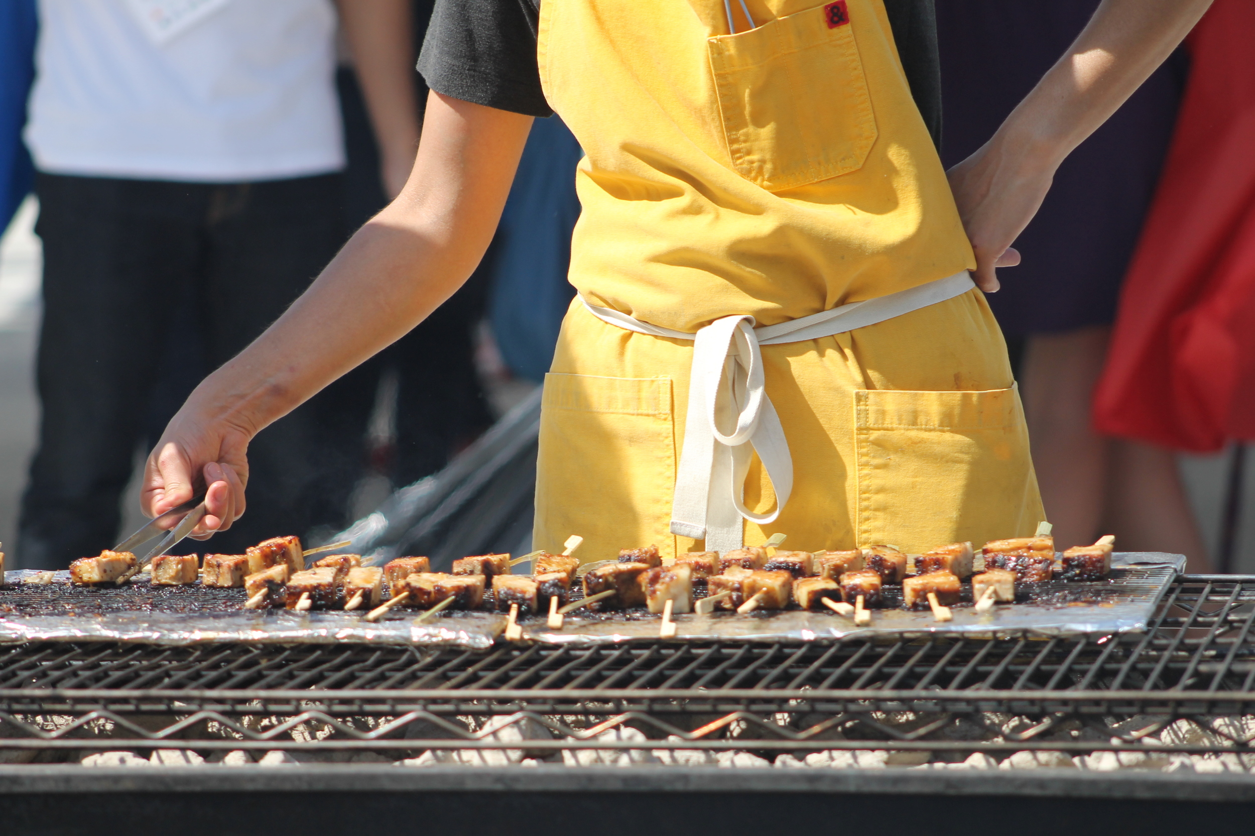 The team from Upland grilling veal ribs that will be later served with charred cherry tomato salsa.