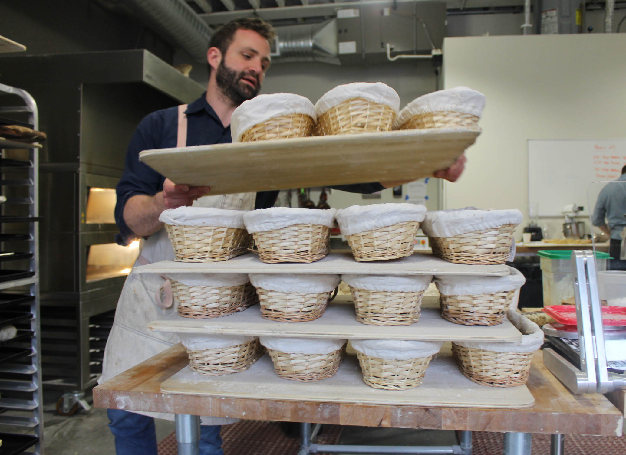 Getting proofing baskets ready.