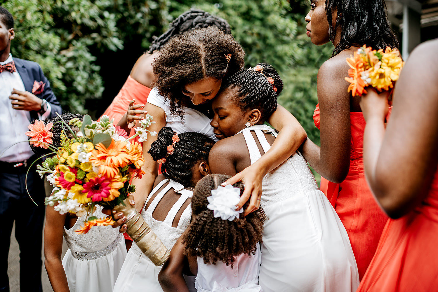 Bride hugging flower girls