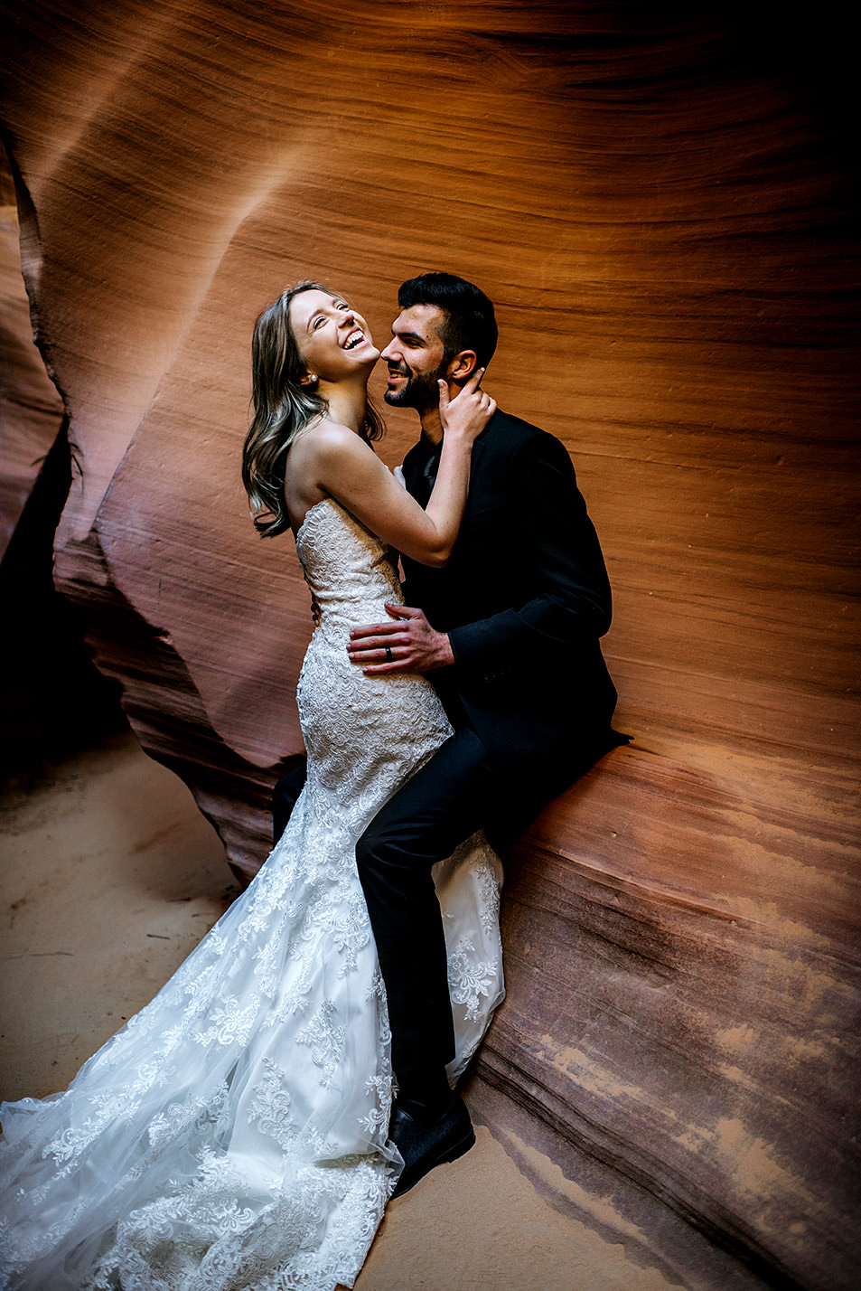 bride and groom laughing in antelope canyon