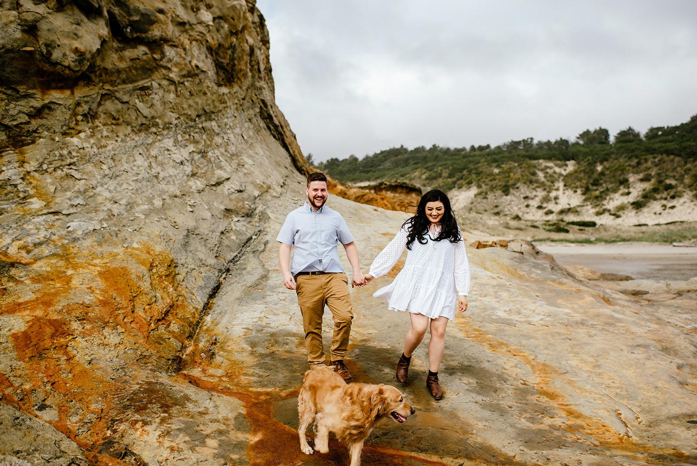 couple walking with Golden retriever at Cape Kiwada