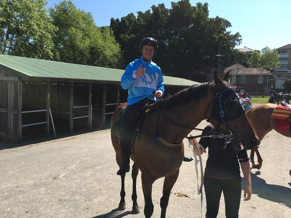 """Jockey Tommy Berry gives a """"Thumbs Up"""" after the trail of PROMPT RESPONSE at Royal Randwick on Friday"""