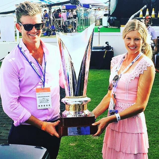 Julian Blaxland & partner Kacy Fogden with Sunlight's 2018 $2m Magic Millions Classic trophy