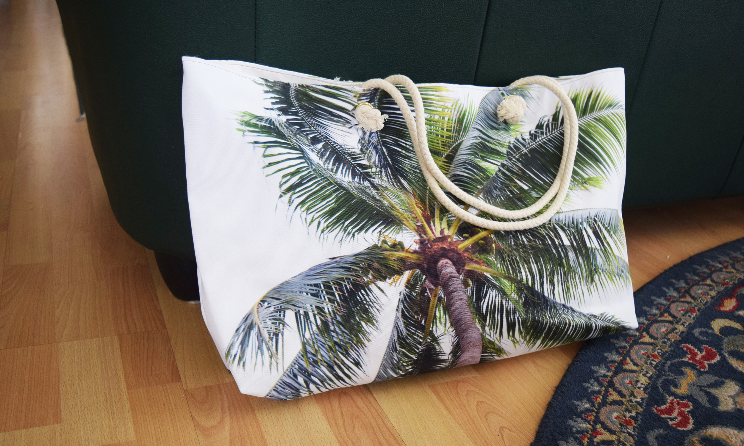 Caribbean Palm Weekender Tote against Couch 2500x1500.jpg