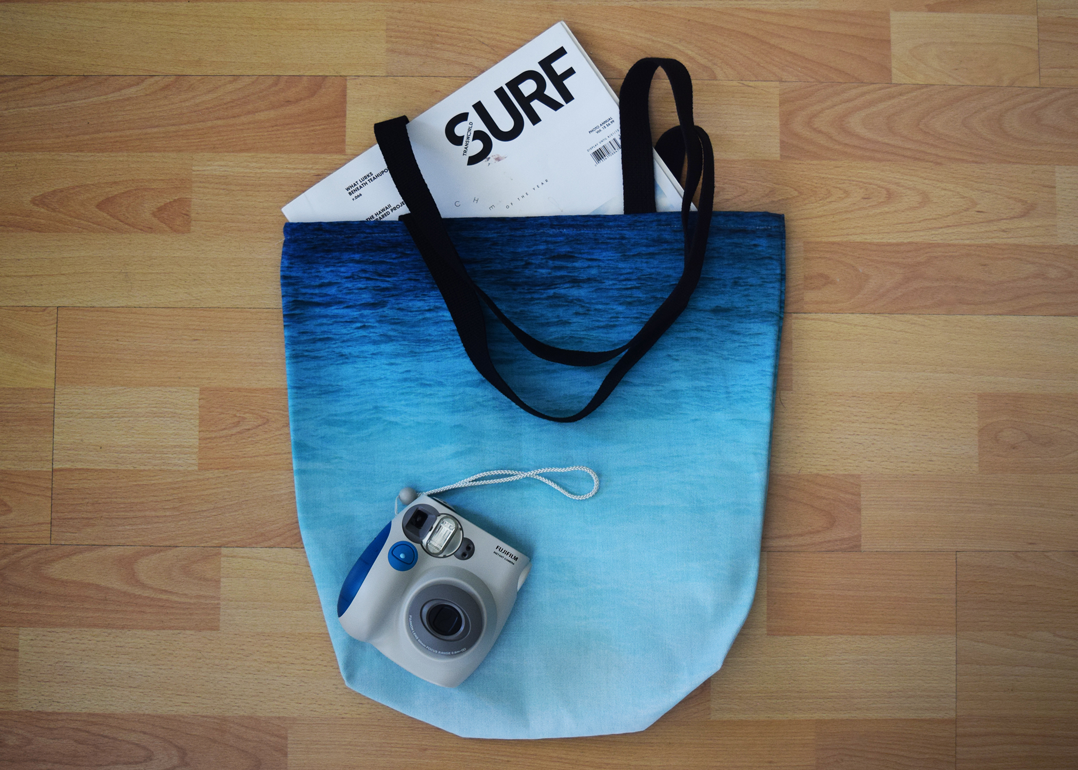 grand cayman waters tote on floor with magazines and instax camera.jpg