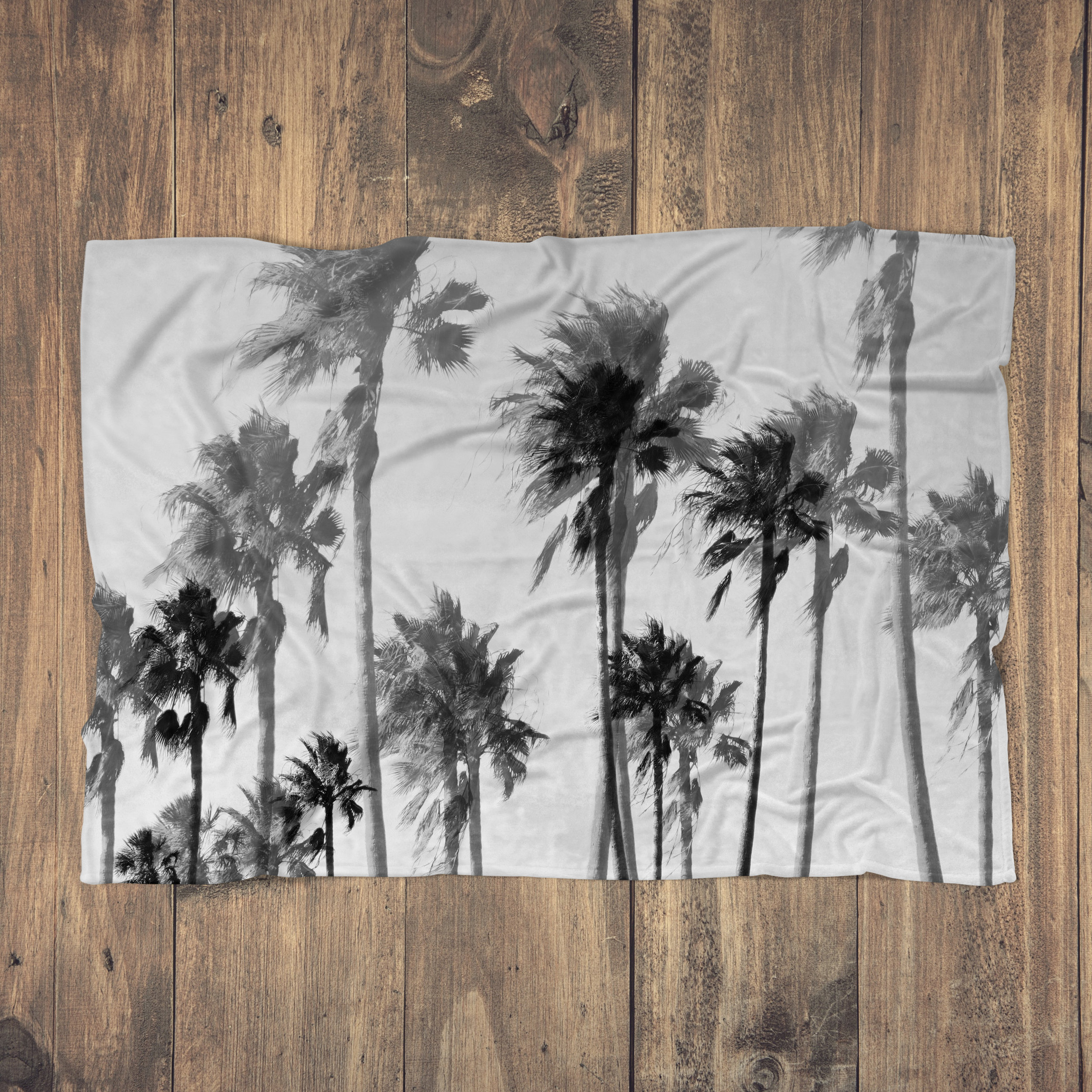 Gainsboro Palms - Fluffy Blanket - Hero Shot - Wood Floor.jpg