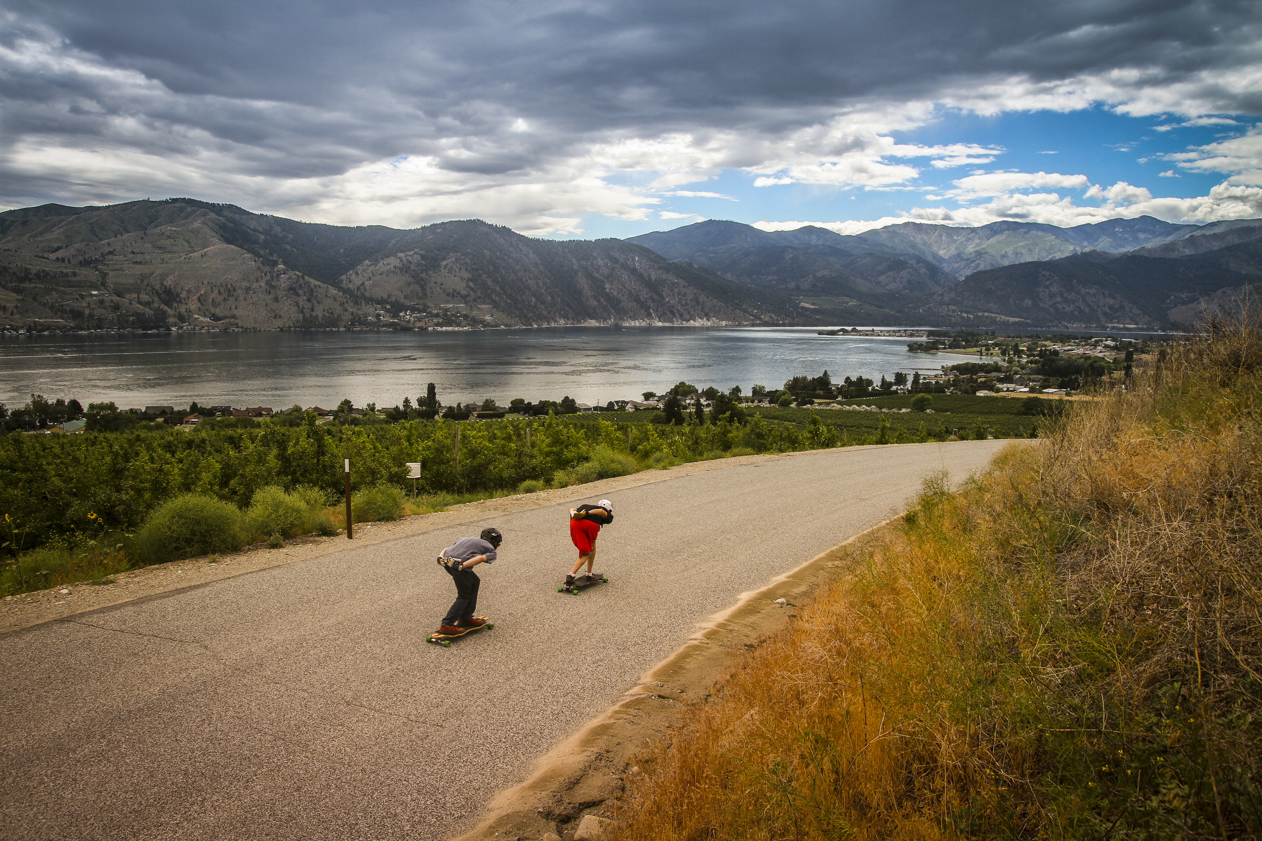 Jake and Kyle cruising down a hill in Chelan, WA