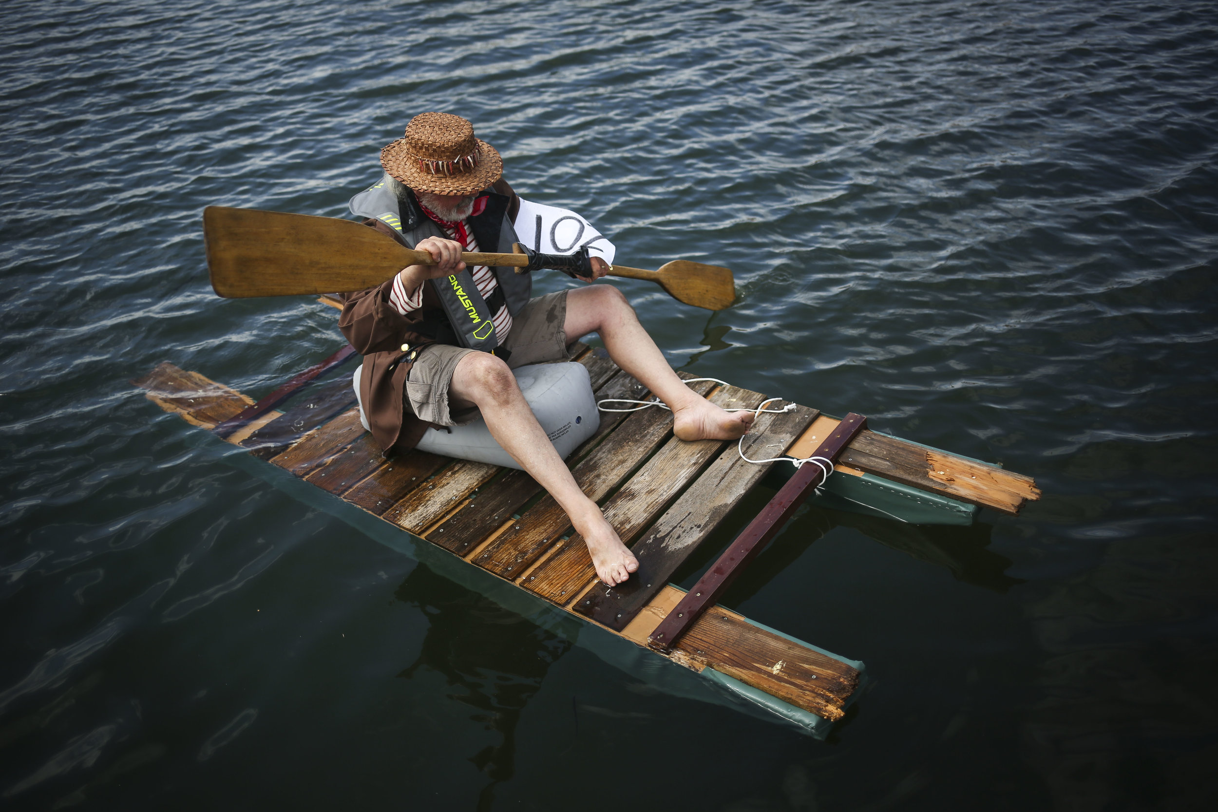 Bob Knapp, who introduced the George Raft Race to Blaine's annual Drayton Harbor Days event, attempts to keep his raft from sinking before the start of the race.