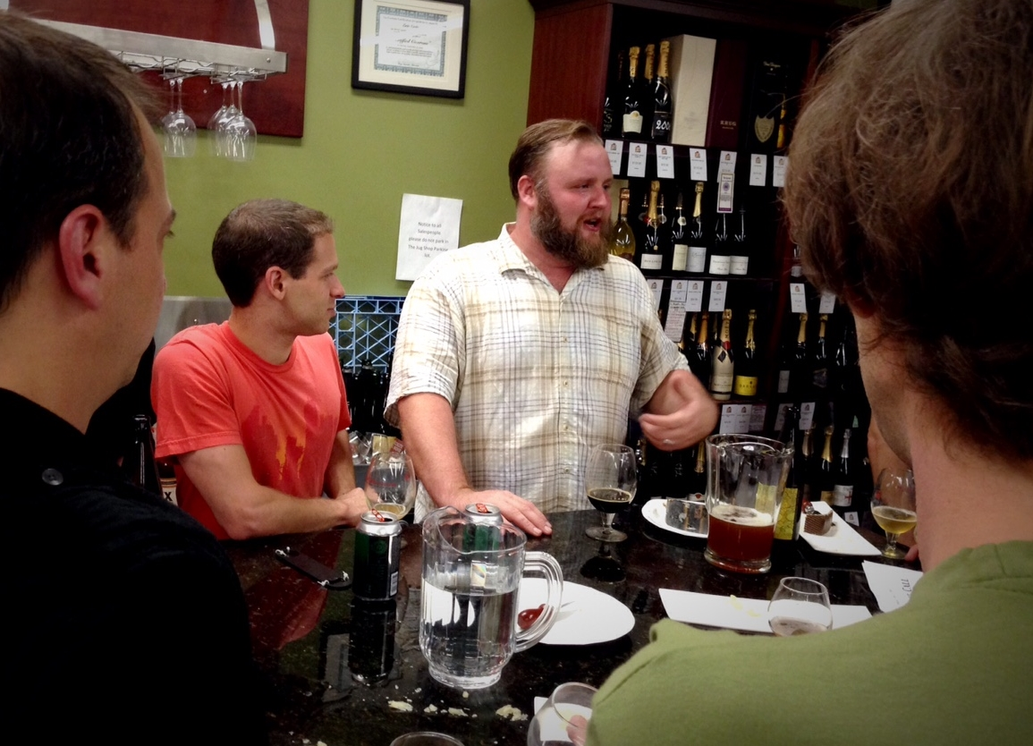 "Eric Cripe talks beer with the crowd at his big ""Eric's Last Call"" going away tasting at The Jug Shop"