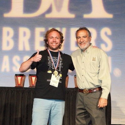 "Social brewmaster Kim Sturdavant accepting the Gold Medal for ""Mr. Kite's Pale Ale"" in the ""Classic English - Style Pale Ale"" category at GABF 2015 ( pic here )"