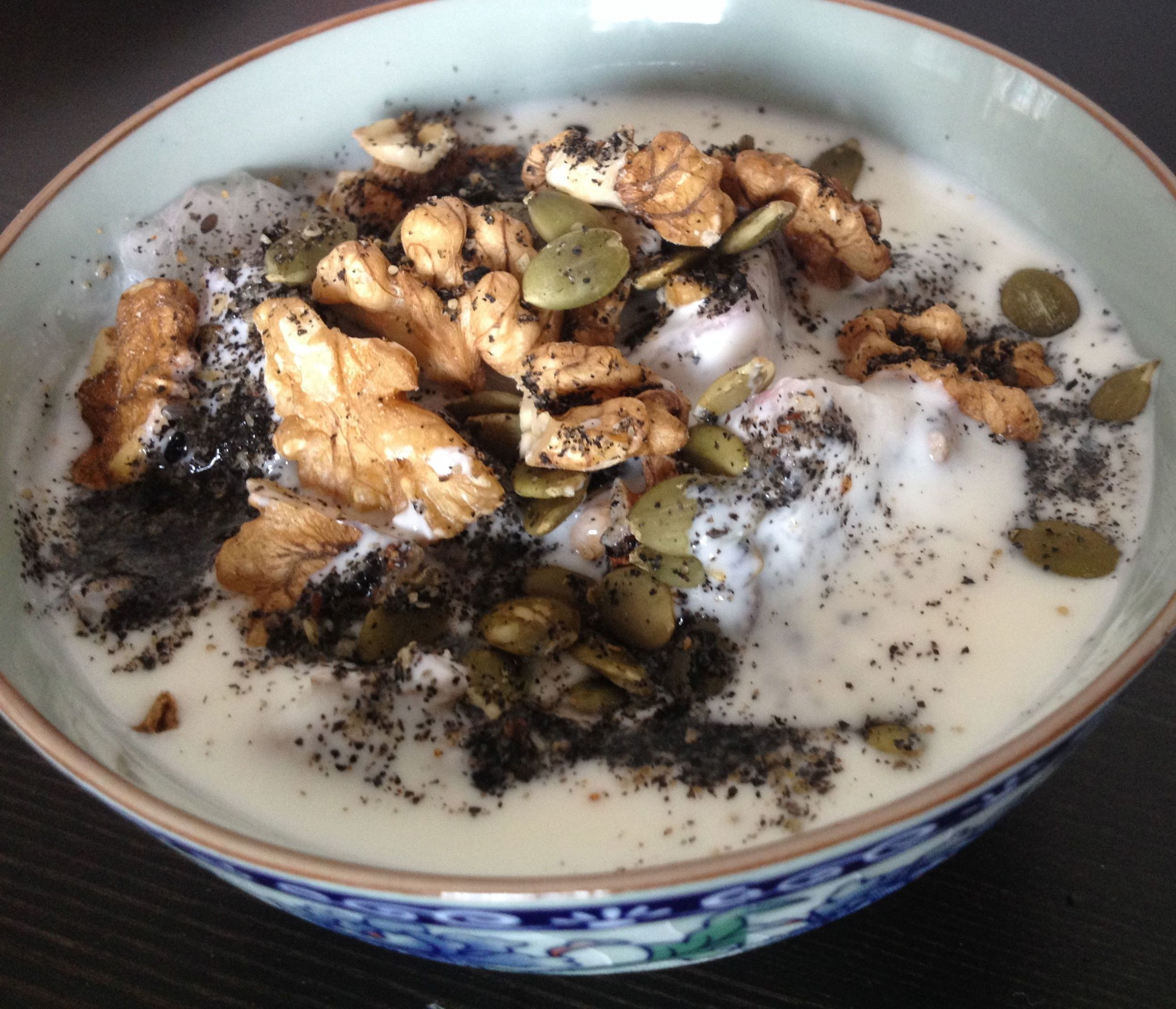 Walnuts, seeds, dragon fruit and topped with black sesame powder
