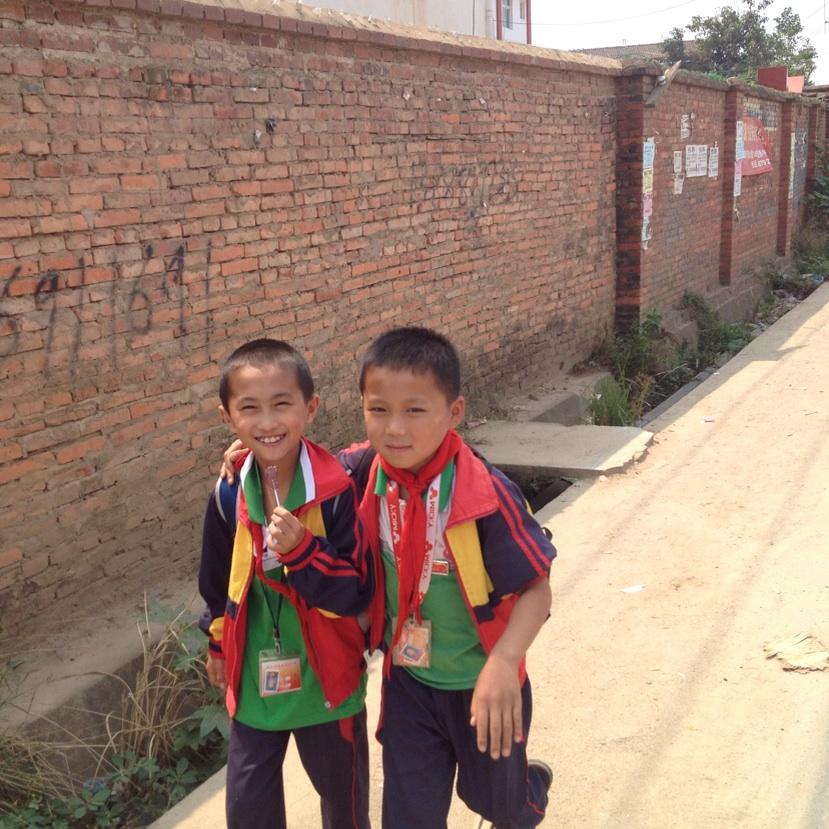 Boys in the village in their school uniforms