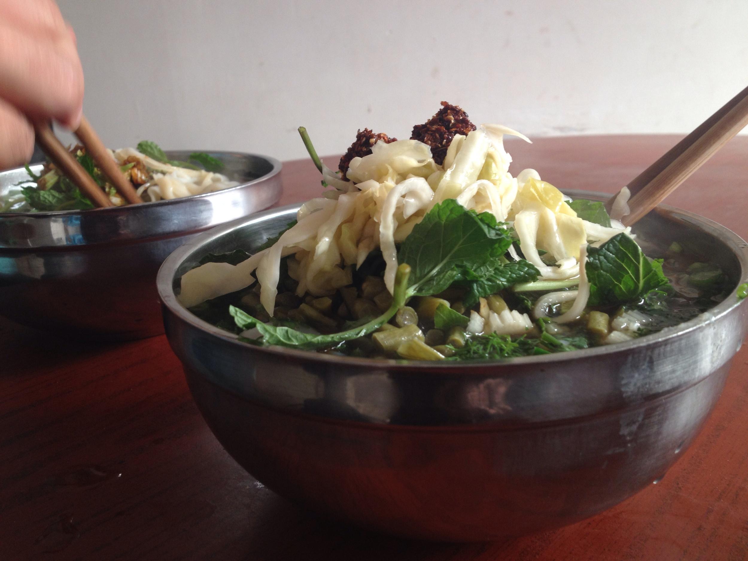 5 Kuai local noodles with fresh herbs, veggies and chili. Y-U-M
