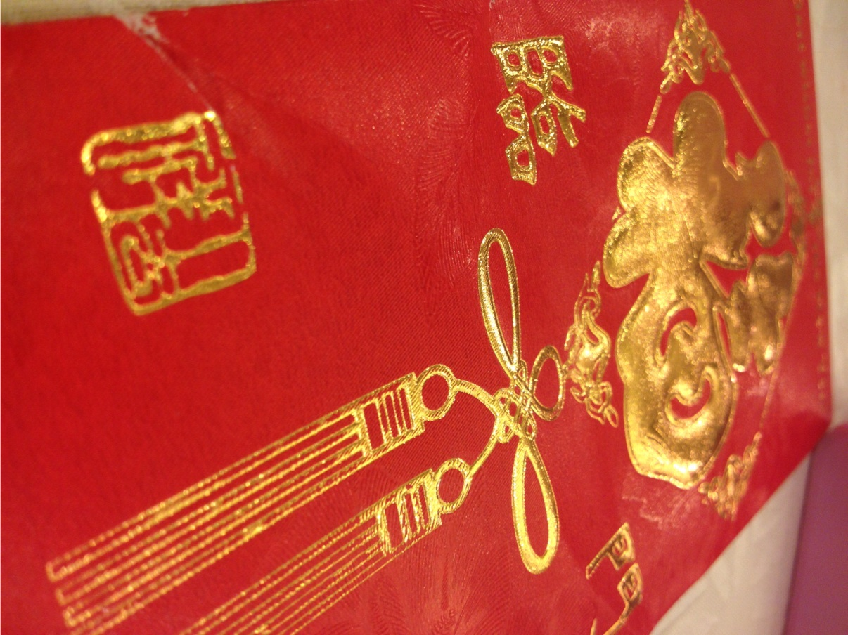 Instead of actual gifts guests give the married couple money in these traditional red envelopes and write a personal note on the back
