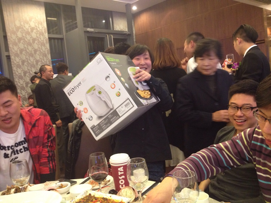 The lucky winner of a non-oil frying machine. She was VERY happy