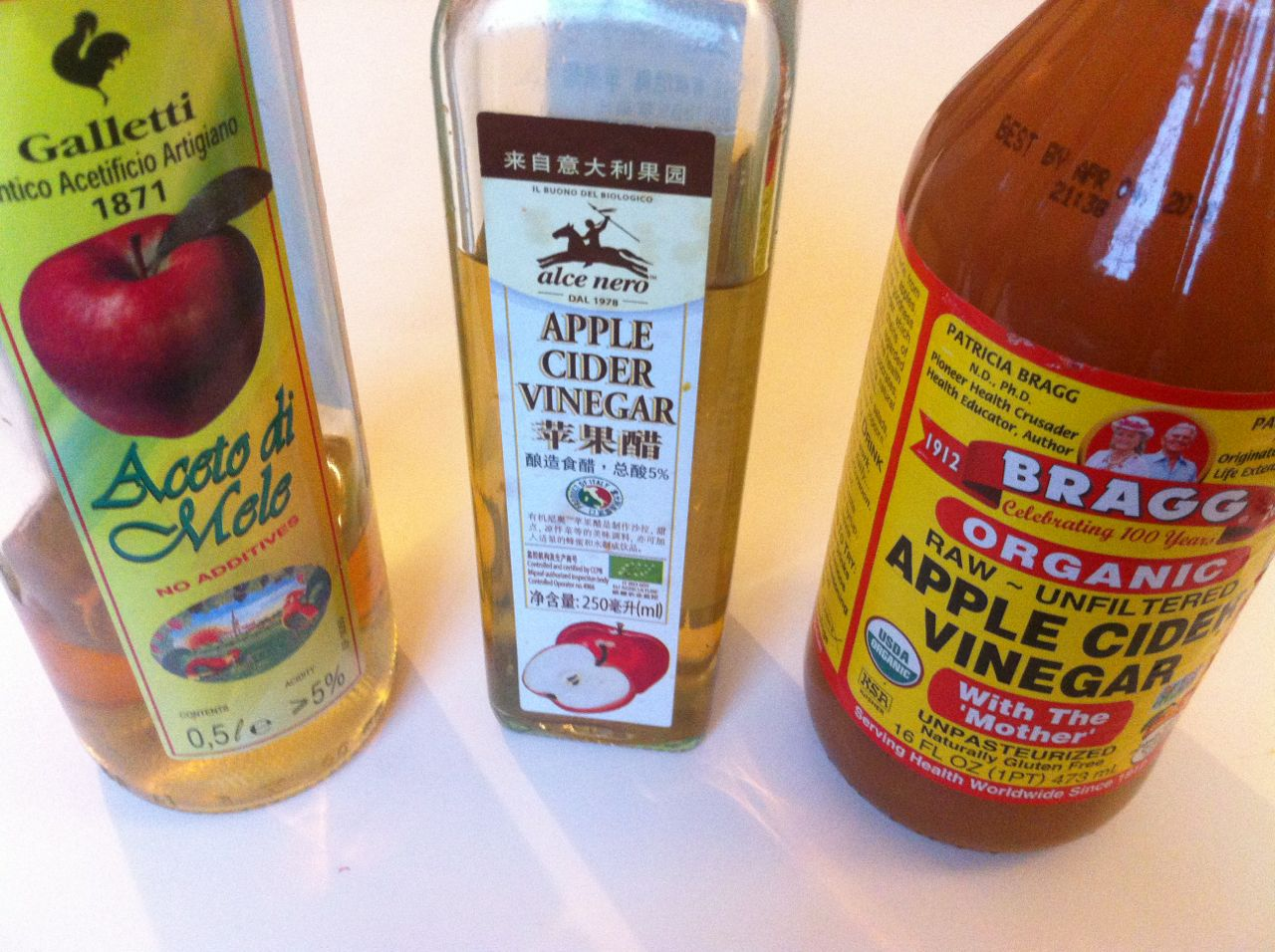 """Aceto di Mele was around RMB 20 in O'le and I use it for cleaning. The bottle in the middle was a bit more due to an """"organic"""" label but as the ACV liquid is see-through it's clearly  no  t  raw and unfiltered. I currently use this for cleaning fruits & veggies but I would use the cheaper one for this as well. The BRAGG's to the right is famous for being the """"real"""" Apple Cider Vinegar containing the """"mother"""" of vinegar and this is the one I drink."""