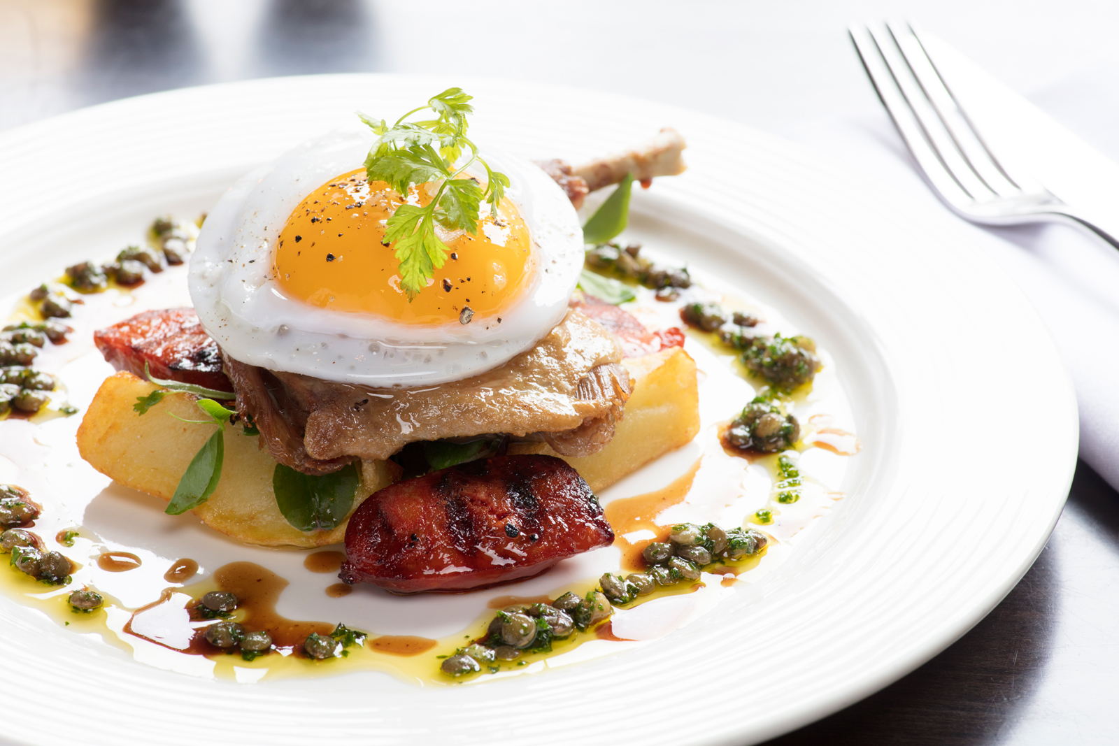 Confit Duck Leg with Chorizo & Puy Lentils with Fried Duck Egg