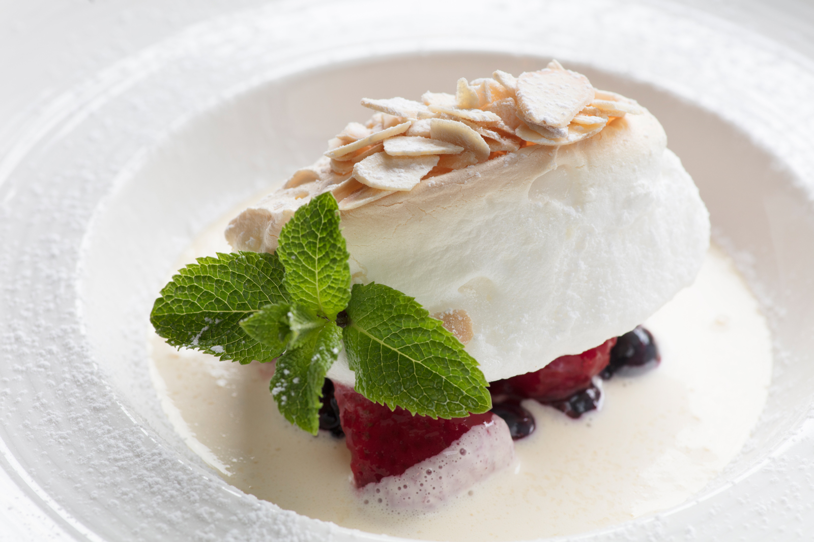 Baked Isle Flottante with Summer Berries & Toasted Almonds