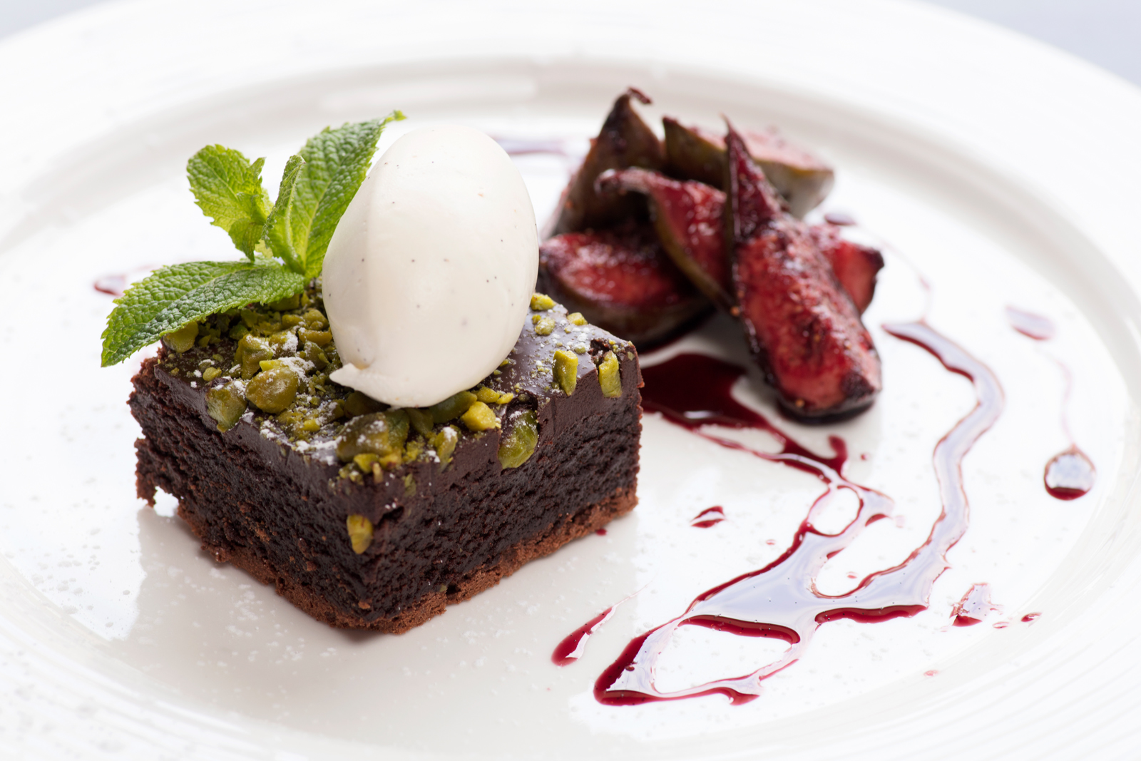 Warm Chocolate & Pistachio Brownie with Creme Chantilly & Red Wine Poached Figs