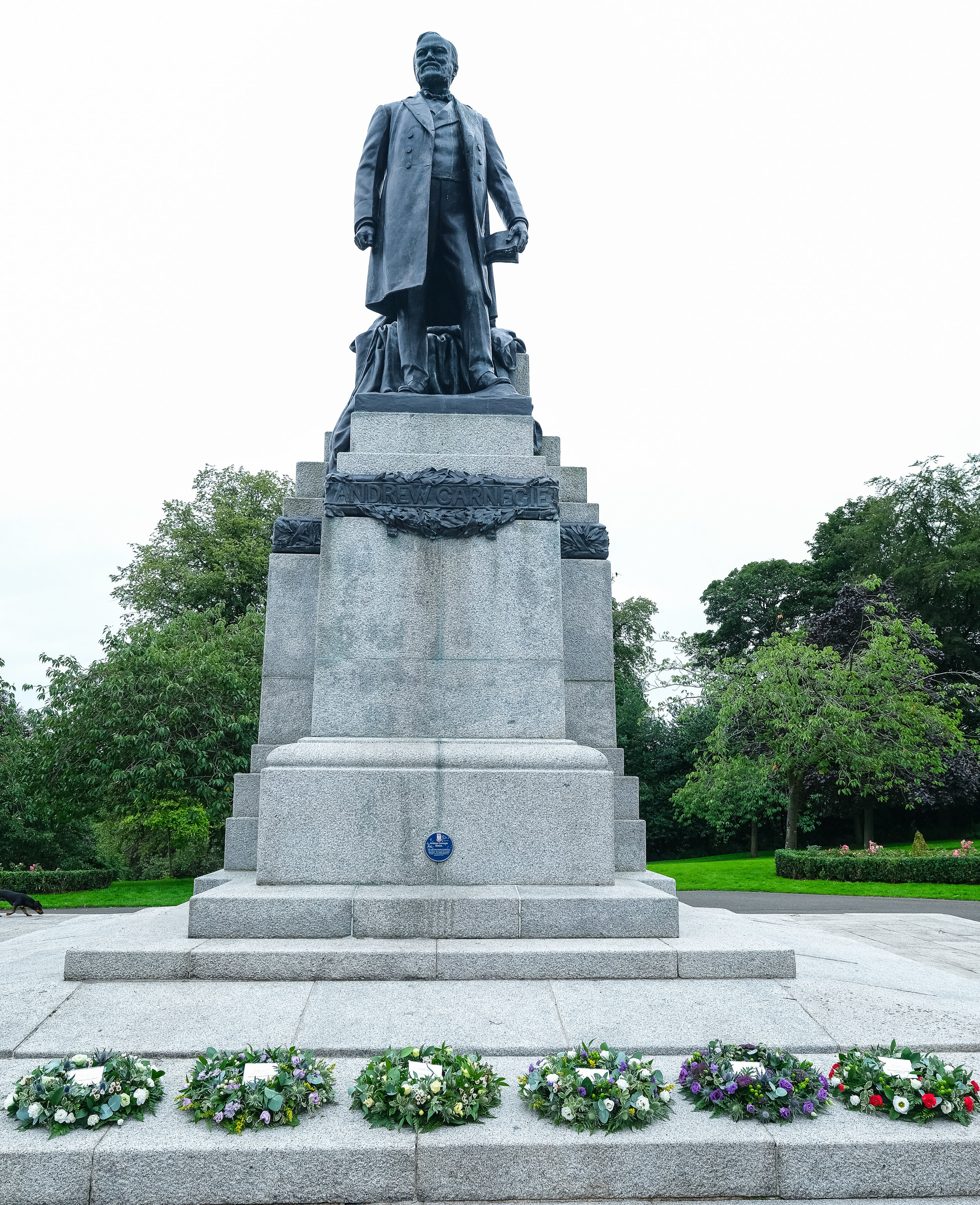 Andrew Carnegie's statue with commemorative wreaths