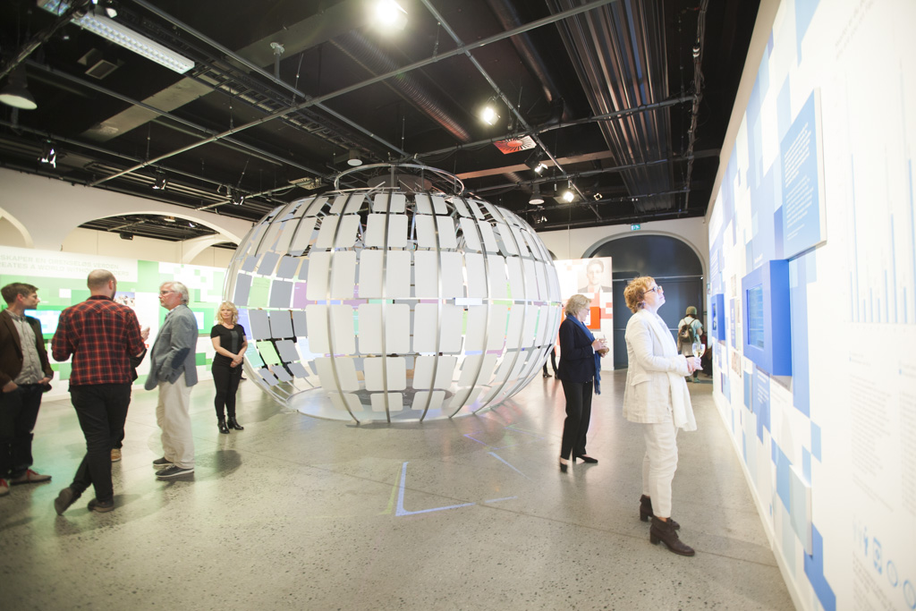 Visitors exploring the exhibition during the opening on 14 May 2014
