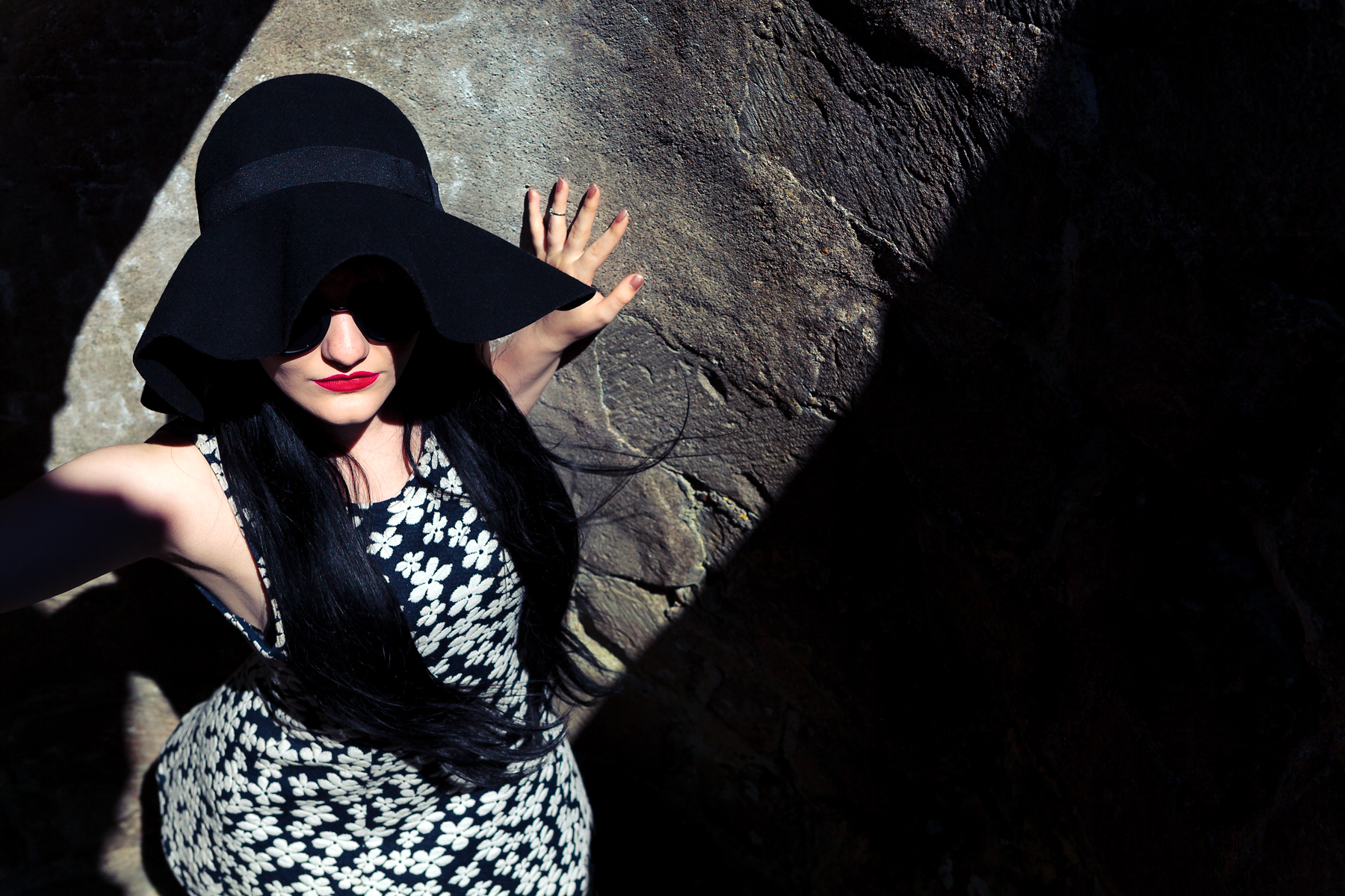 Woman in a hat in shadow