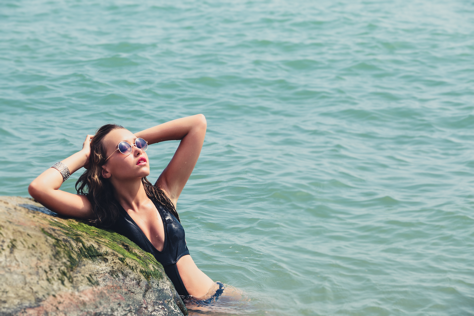 Girl in sunglasses in the sea