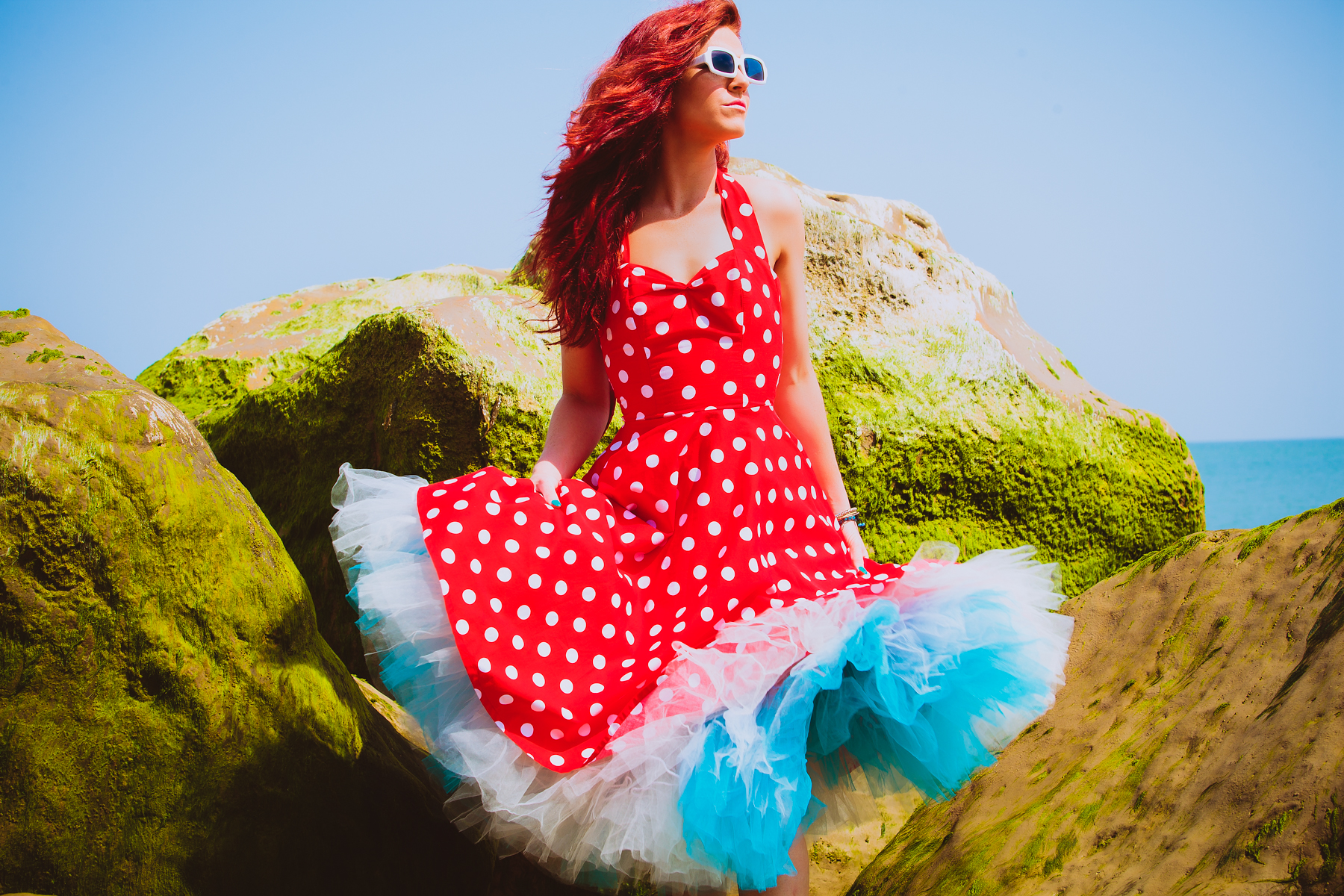 Woman with red hair in a red dress