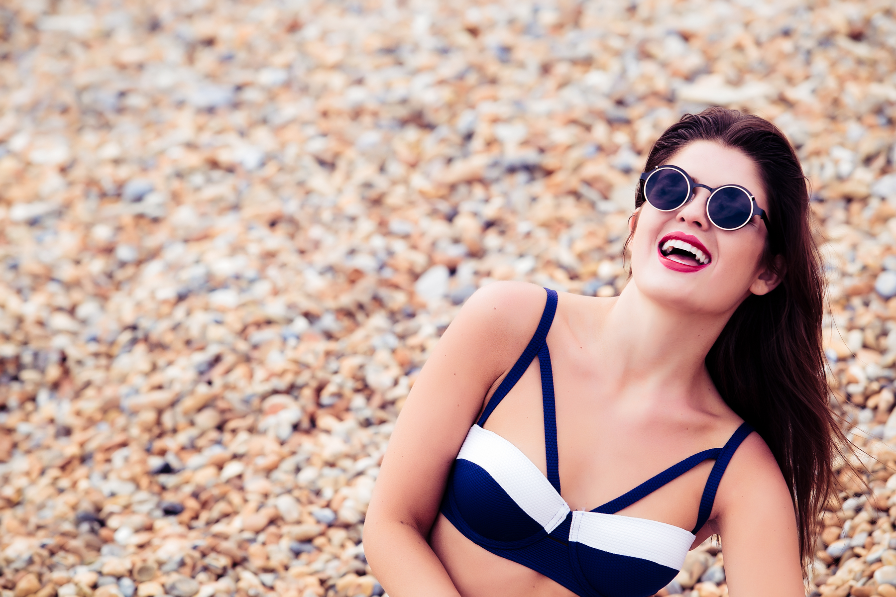 Woman laughing on a beach