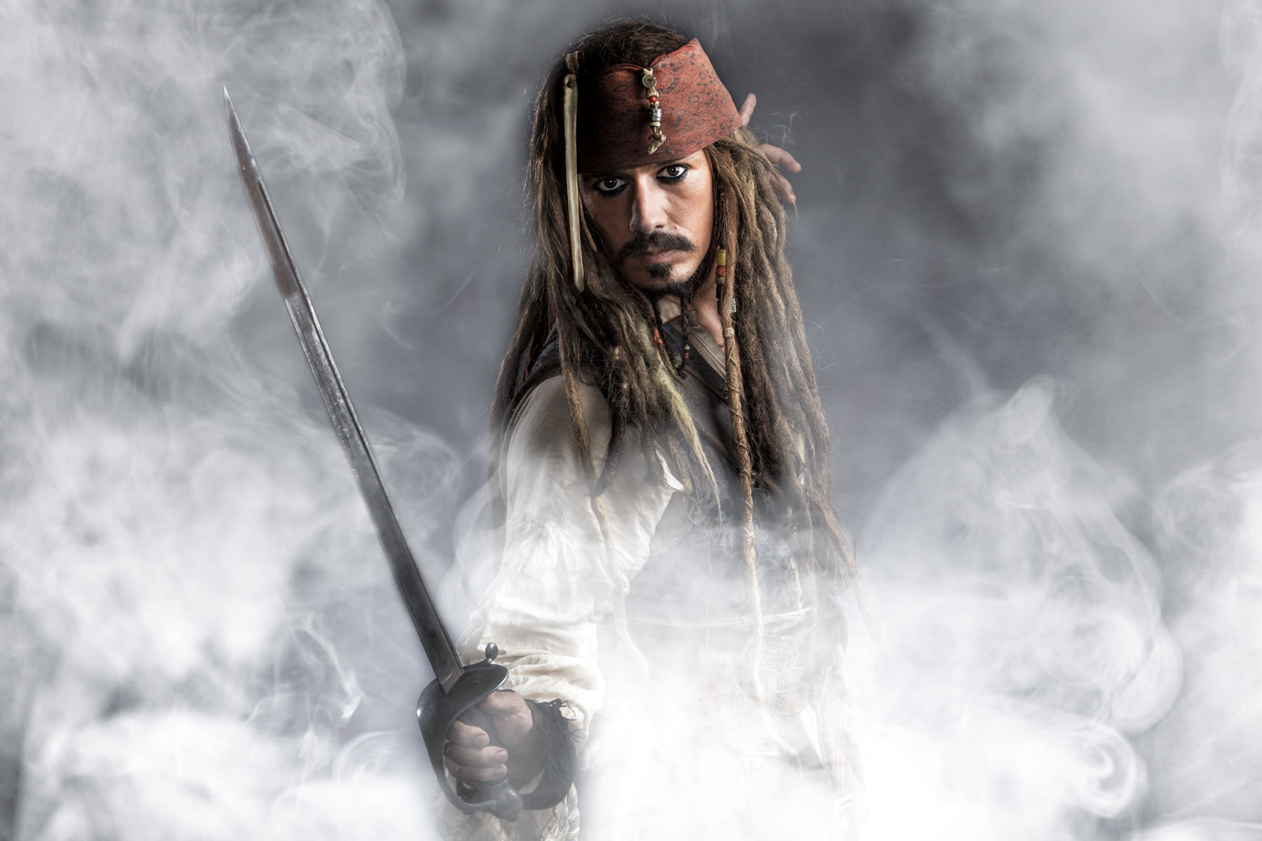 Jack Sparrow with sword in smoke