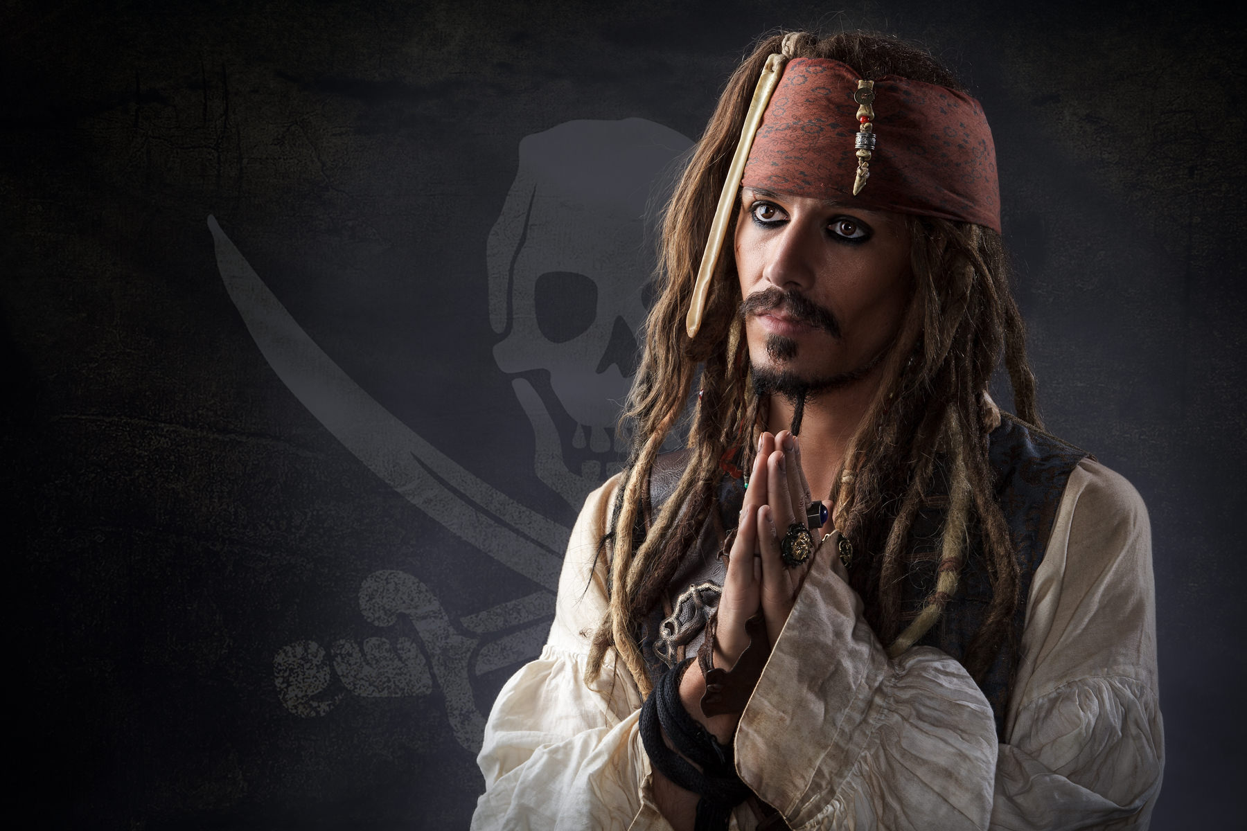 Jack Sparrow praying with skull & crossbones