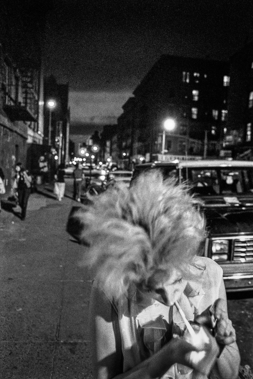Ken Schles - Claudia Lights Up, 1985.jpg
