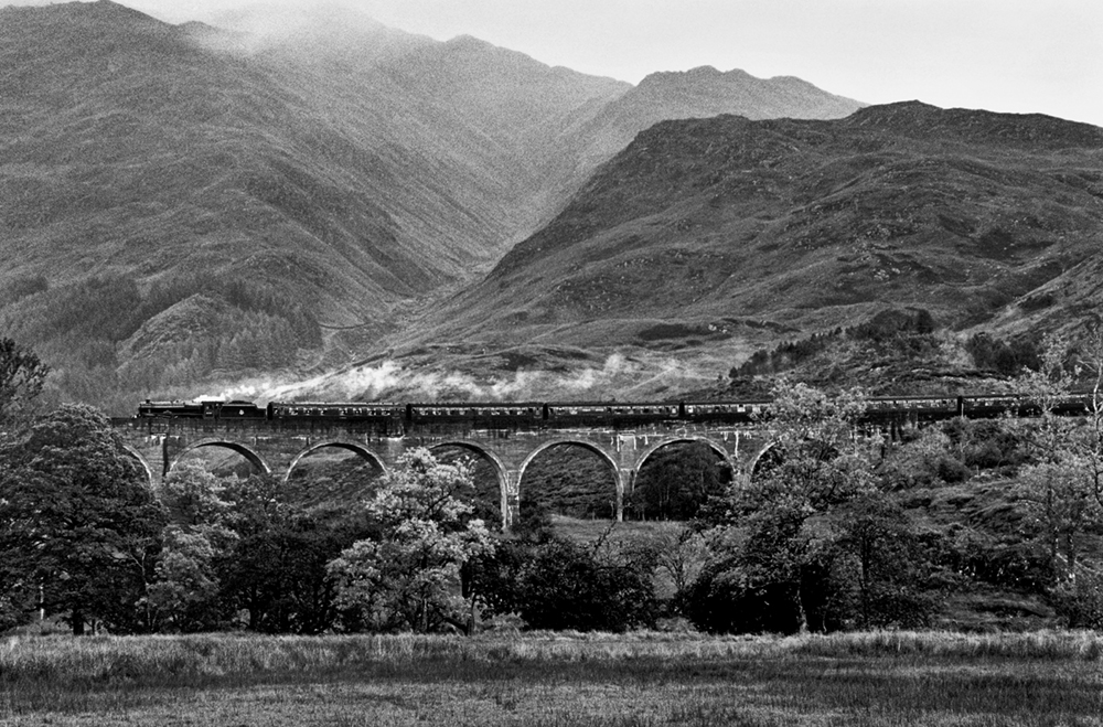 The Jacobite Steam Train, Glenfinnan Viaduct, Lochaber, Highlands, Scotland, 2012  Photo © 2018 Elliott Erwitt/Magnum Photos. All rights reserved.