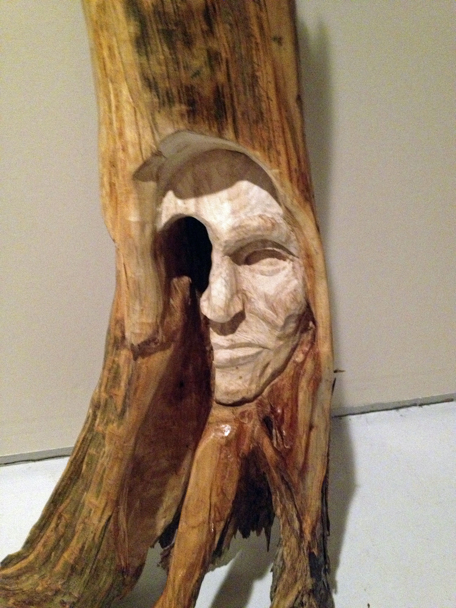 The piece that I showed my wife. It did not start out to be half a face, but it actually became more interesting; you never know where the wood will take you.