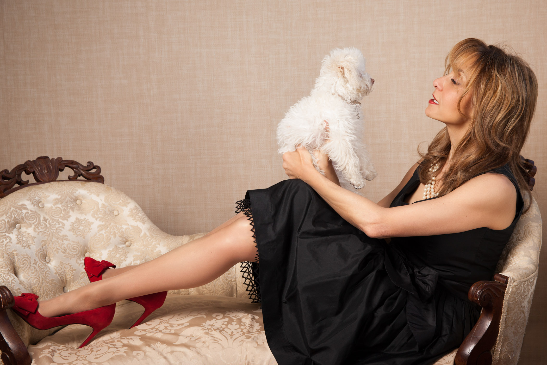 woman-in-red-lipstick-holding-her-puppy