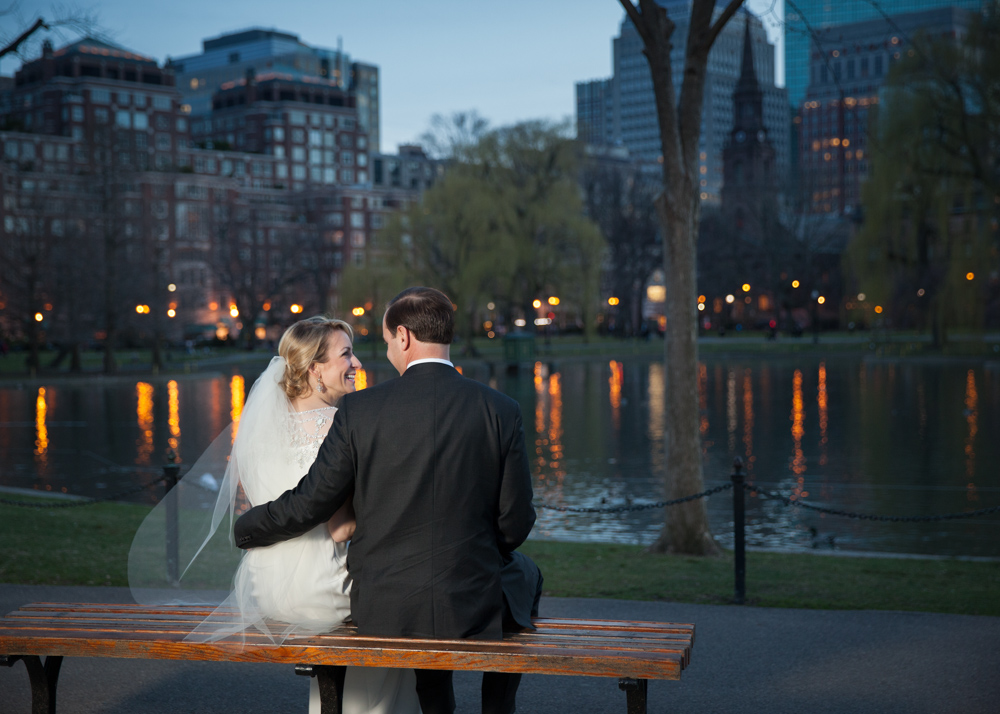 couple-sits-at-frog-pond-in-public-garden