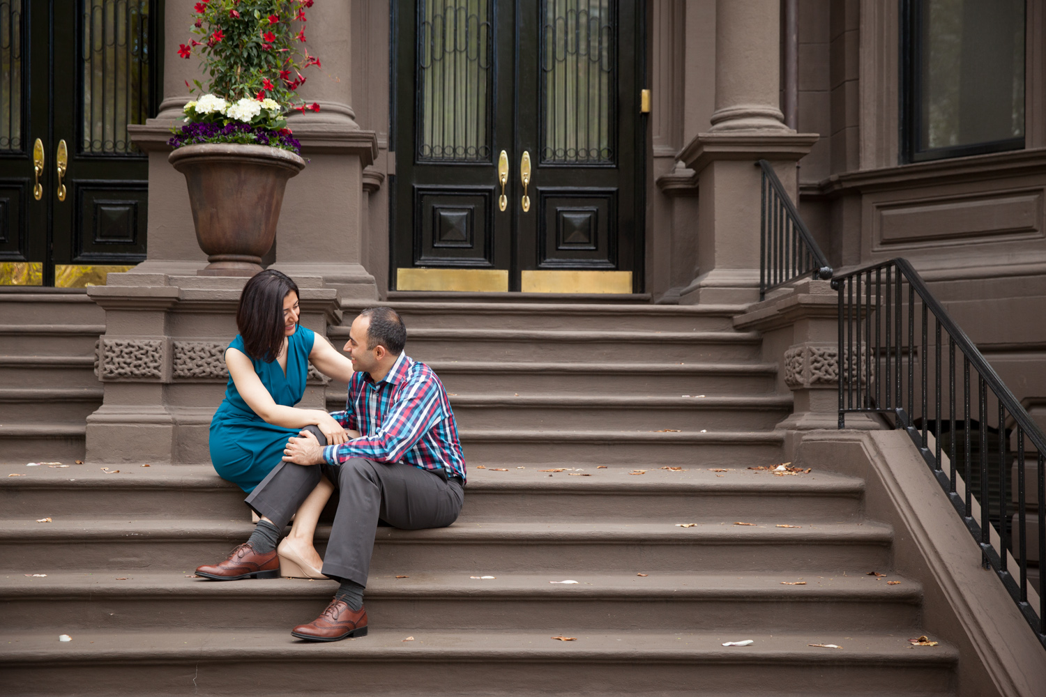 couple-sitting-on-brownstone-stairs-commonwealth-avenue-boston-back-bay.jpg