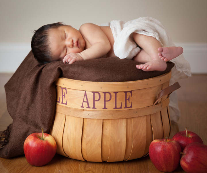 This autumn newborn was perfect for the apple picking theme we chose. We found the apple basket first, then stuck with the fall color scheme, and added real apples for detail impact