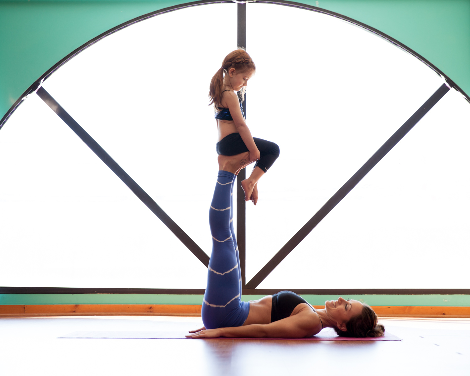 Haley doing yoga with her oldest daughter