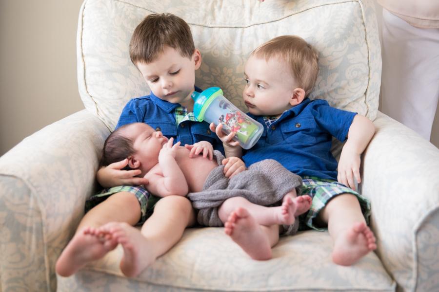 north-shore-brothers-cuddle-newborn-family.jpg