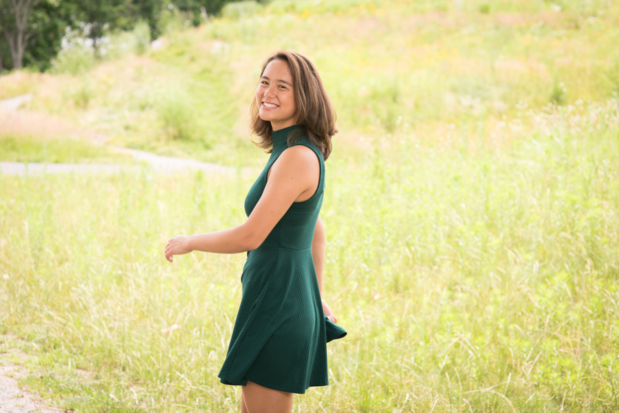 boston-portrait-photography-twirling-smiling-girl-nature-grass-field-laughing.jpg