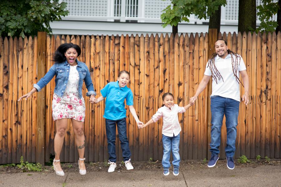 dorchester-boston-family-photos-rainy-outdoor-creative-puddle-jumping-.jpg
